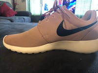 unpaired white and black Nike running shoe Riverview, 33578