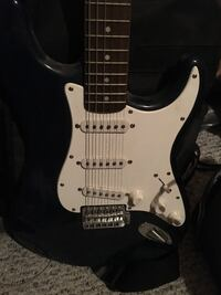 Navy and white Fender Squire Strat Electric Guitar w/ amp