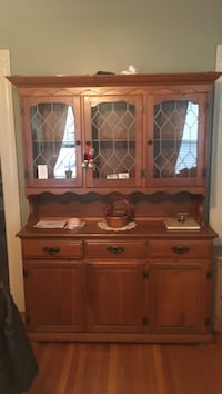 Brown wooden display cabinet with drawers