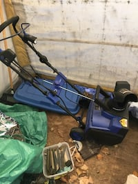 Black and blue push snow thrower