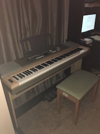 white and gray electric keyboard with seat chair