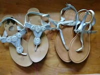 two pairs of brown and white leather sandals Oroville