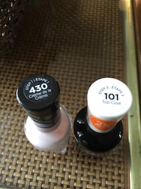 two black and white nail polishes Warman, S0K 4S2