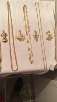 gold-colored pendants and necklaces