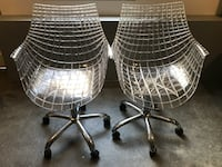 two clear rolling armchairs