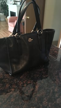 Black coach leather excellent condition