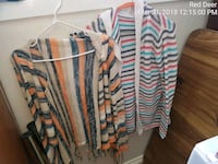 two white and orange striped long-sleeved cardigans