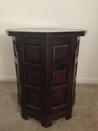 Brown wooden glass top 2-door side table. I have two. The price listed is for one. Mc Lean, 22102