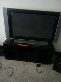 black flat screen TV with black wooden TV stand Milwaukee, 53208