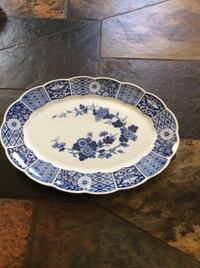 white and blue floral ceramic plate