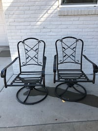 Black metal outdoor chairs. One has a loose strap but could easily be fixed. They swivel and rock!! Wheat Ridge, 80033