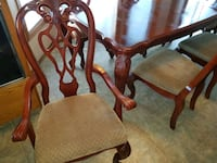brown wooden framed padded armchair Red Deer, T4N 6S3