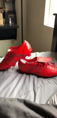 pair of red Adidas cleats Long Beach, 90813