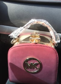 pink and white leather crossbody bag 522 mi