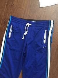 blue and white Adidas track pants Surrey