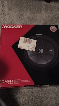 Black and red kicker subwoofer box 322 mi