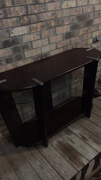 black wooden framed glass top TV stand Saraland, 36571
