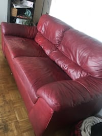 Red leather 2-seat sofa Vancouver, V6E 1W6