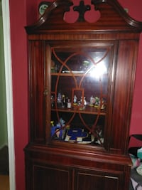 brown wooden framed glass display cabinet Manassas