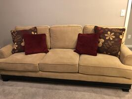 Brown fabric sofa and chair with throw pillows
