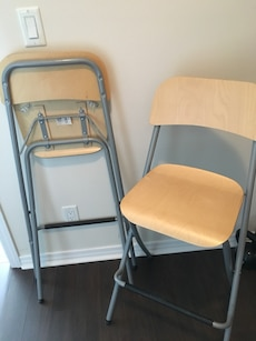 two gray steel folding chairs