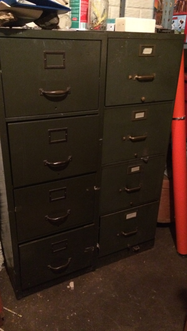 Two heavy steel filing cabinets