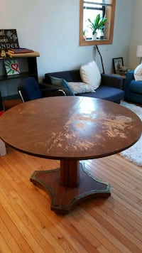 Round brown wooden dining table Washington, 20009