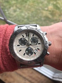 round silver chronograph watch with silver link bracelet Columbus