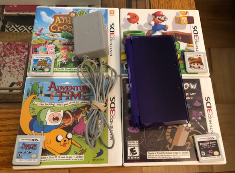 Nintendo 3DS (Purple), charger, and four games  7c7cc806-87f2-4a2c-ac87-95bd60569831