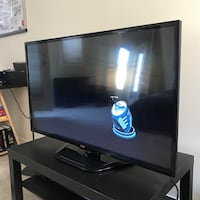 black flat screen TV with remote Toronto, M6J 3W8