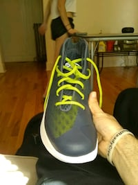 pair of gray-and-yellow under armour steph currys Lincoln, 68502