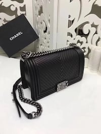 black Chanel quilted leather crossbody bag
