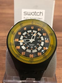 Black and yellow Swatch analog watch NEW with 1 year warranty !
