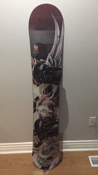 Black and brown snowboard with bindings