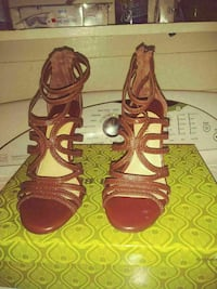 pair of brown leather strappy open-toe heeled sandals