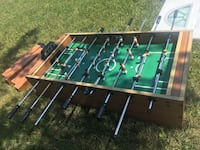 brown and green foosball table Orient, 43146