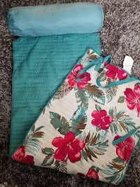 teal, white, and red floral beach blanket