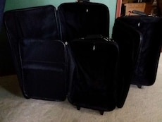 Suitcases-3 different sizes all fit together
