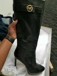 pair of black leather knee-high boots 528 mi