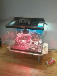55 gallon tall with top light and screen half top  719 km