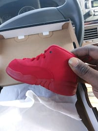 unpaired red Air Jordan 13 shoe Cincinnati