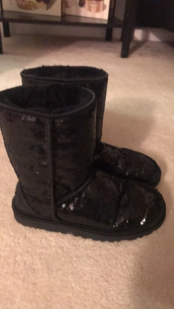 pair of sequin black UGG sheepskin boots