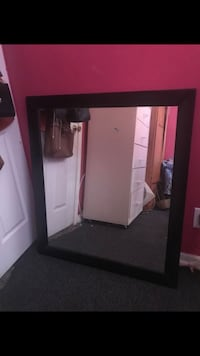 rectangular brown wooden framed mirror