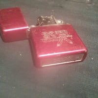 red KT Tobacco lighter Cambridge, N1R 4M1