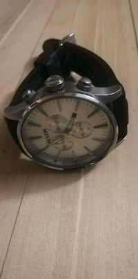 round silver-colored chronograph watch with black leather strap 539 km