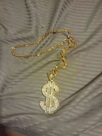 diamond and gold Dollar Sign pendant necklace