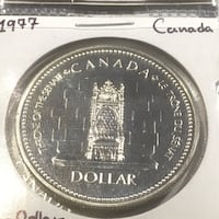 1977 Silver dollar in 2x2 case Edmonton