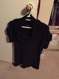 Ladies black sweater, with a loose turtle neck. Pick up Brampton Brampton, L6T 4A8
