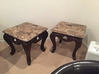 two gray granite top side tables
