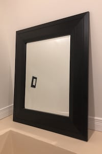 Medium Sized Mirror with Black Frame Toronto, M4C 2B3